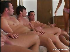Four guys work over a gorgeous black haired babe in a gangbang