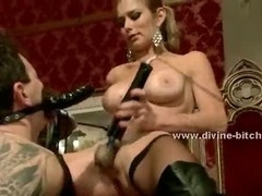 Two submissive men are made to lick Mistress boots after having their asses toyed with