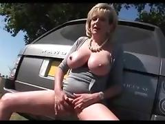 MILF FINGERING ON COUNTRY SIDE...HUGE MELONS!!
