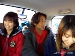 Cute teen asians having fun in the car
