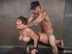 Busty bombshell enjoys pleasuring two massive dicks in the dungeon