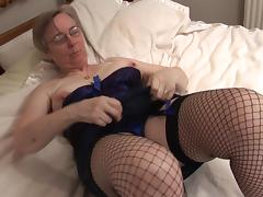 Old woman in stockings likes exploring her dripping wet love hole