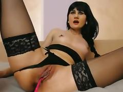 Gothic long stockings in bed masturbating