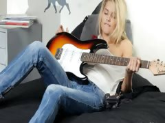 delicate blonde and her guitar