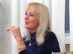 Horny mature blonde sucks on hard cock