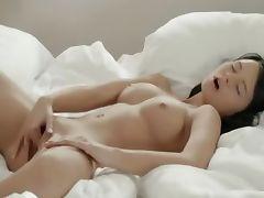 Brunette woman fingering pussy in whtie
