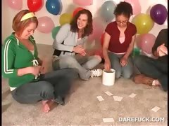 Party teens kiss in a truth or dare sexgame