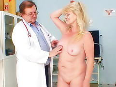 Mature does gyno exam with her doctor