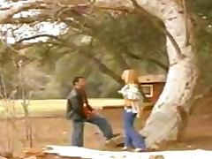 Busty blonde gives boyfriend outdoor blowjob