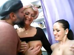 Blonde granny and a pretty brunette share some old nerd's cock