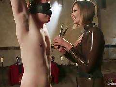 Hot mistress in latex ties the guy up and toys him deep