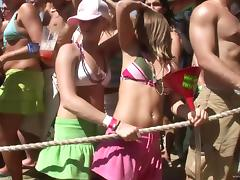 Many sextractive horny bitches getting naked on the beach party