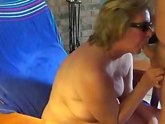 Granny sucks cock and receives cum on breast